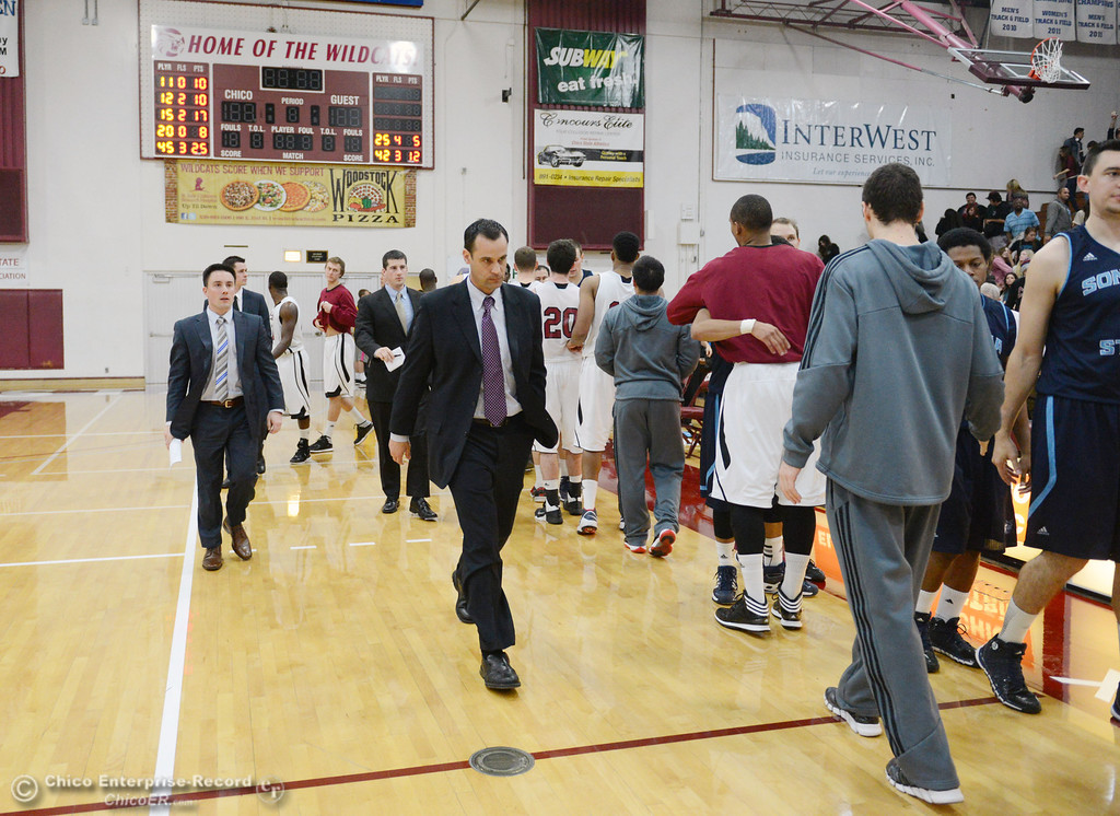 . Chico State coach Greg Clink (center) walks off the court in their against Sonoma State at the end of the second half of their men\'s basketball game at CSUC Acker Gym Friday January 31, 2014 in Chico, Calif. (Jason Halley/Chico Enterprise-Record)