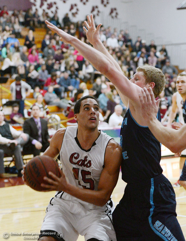. Chico State\'s #45 Jordan Semple (left) dribbles against Sonoma State\'s #24 Mike Harris (right) in the first half of their men\'s basketball game at CSUC Acker Gym Friday January 31, 2014 in Chico, Calif. (Jason Halley/Chico Enterprise-Record)