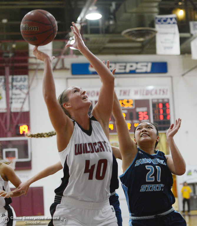 . Chico State\'s #40 Analise Riezebos (left) goes up for a shot against Sonoma State\'s #21 Famh Fong (right) in the second half of their women\'s basketball game at CSUC Acker Gym Friday January 31, 2014 in Chico, Calif. (Jason Halley/Chico Enterprise-Record)