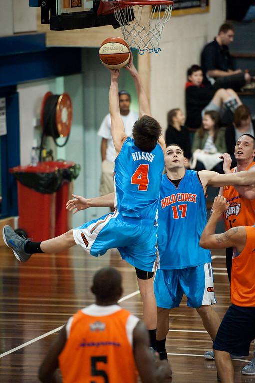 """Brendan Carroll - Cairns Taipans v Gold Coast Blaze Pre-season  NBL Basketball, Auchenflower, Brisbane, Queensland, Australia; 3 September 2011. Photos by Des Thureson:  <a href=""""http://disci.smugmug.com"""">http://disci.smugmug.com</a>."""