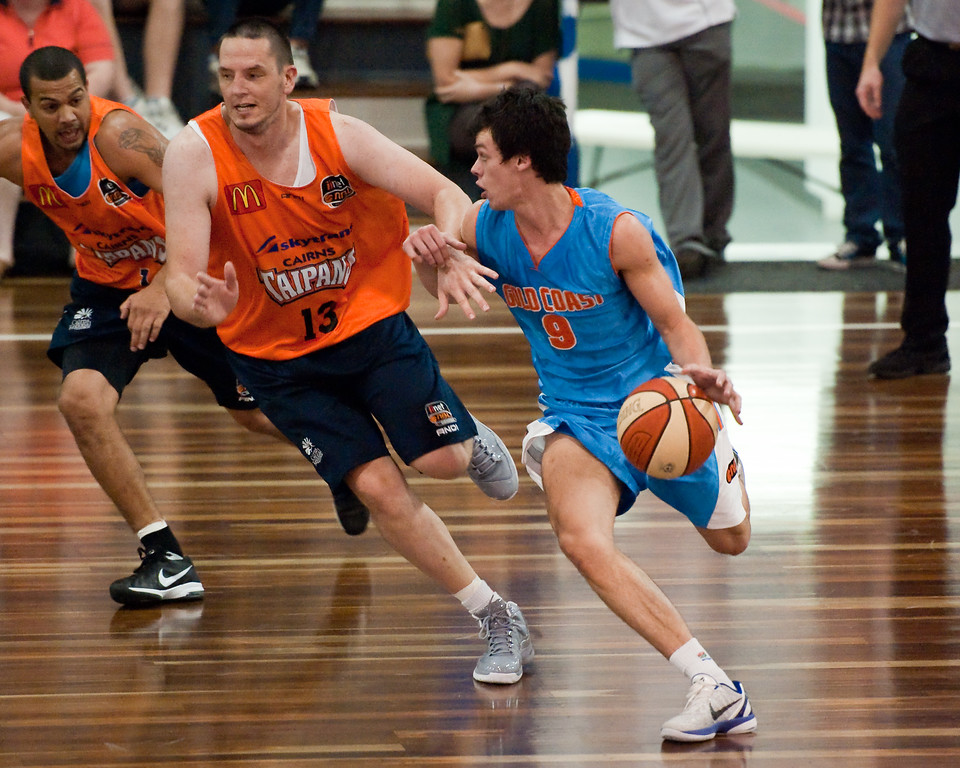 "Jason Cadee, Dean Brebner - Cairns Taipans v Gold Coast Blaze Pre-season  NBL Basketball, Auchenflower, Brisbane, Queensland, Australia; 3 September 2011. Photos by Des Thureson:  <a href=""http://disci.smugmug.com"">http://disci.smugmug.com</a>."