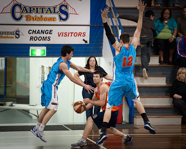 Double Team: Jason Cadee and Will Hudson try to trap Jackson Hussey - Cairns Taipans v Gold Coast Blaze Pre-season  NBL Basketball, Auchenflower, Brisbane, Queensland, Australia; 3 September 2011. Photos by Des Thureson:  http://disci.smugmug.com.