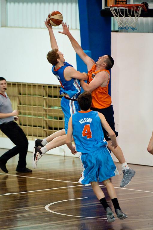 """Tom Garlepp - Cairns Taipans v Gold Coast Blaze Pre-season  NBL Basketball, Auchenflower, Brisbane, Queensland, Australia; 3 September 2011. Photos by Des Thureson:  <a href=""""http://disci.smugmug.com"""">http://disci.smugmug.com</a>."""