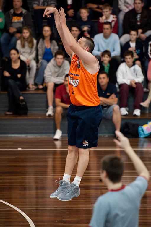"""Dean Brebner - Cairns Taipans v Gold Coast Blaze Pre-season  NBL Basketball, Auchenflower, Brisbane, Queensland, Australia; 3 September 2011. Photos by Des Thureson:  <a href=""""http://disci.smugmug.com"""">http://disci.smugmug.com</a>."""