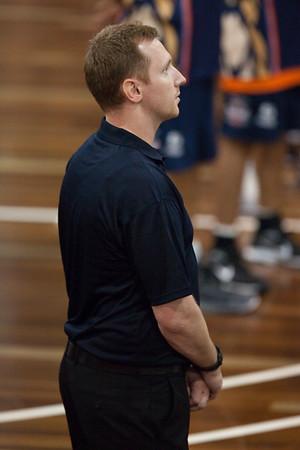 """Taipans Assistant Coach Mick Downer - National Anthem - Cairns Taipans v Gold Coast Blaze Pre-season  NBL Basketball, Auchenflower, Brisbane, Queensland, Australia; 3 September 2011. Photos by Des Thureson:  <a href=""""http://disci.smugmug.com"""">http://disci.smugmug.com</a>."""