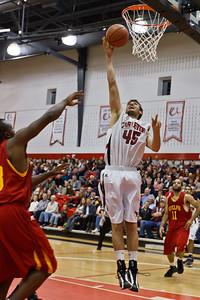 Dan Penner to the hoop hard