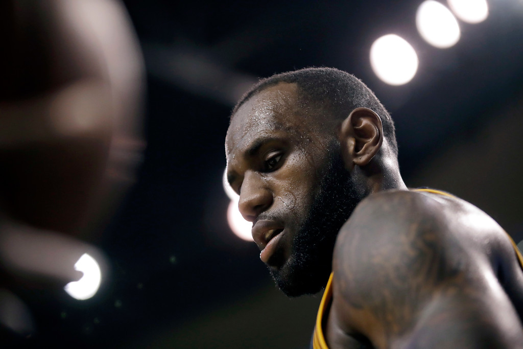 . Cleveland Cavaliers forward LeBron James walks upcourt during first half of Game 2 of the NBA basketball Eastern Conference finals against the Boston Celtics, Friday, May 19, 2017, in Boston. (AP Photo/Elise Amendola)