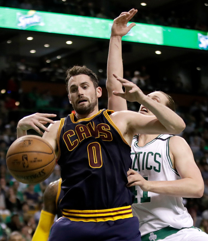. Cleveland Cavaliers forward Kevin Love (0) and Boston Celtics center Kelly Olynyk, right, fight for the ball during the first half of Game 2 of the NBA basketball Eastern Conference finals, Friday, May 19, 2017, in Boston. (AP Photo/Elise Amendola)
