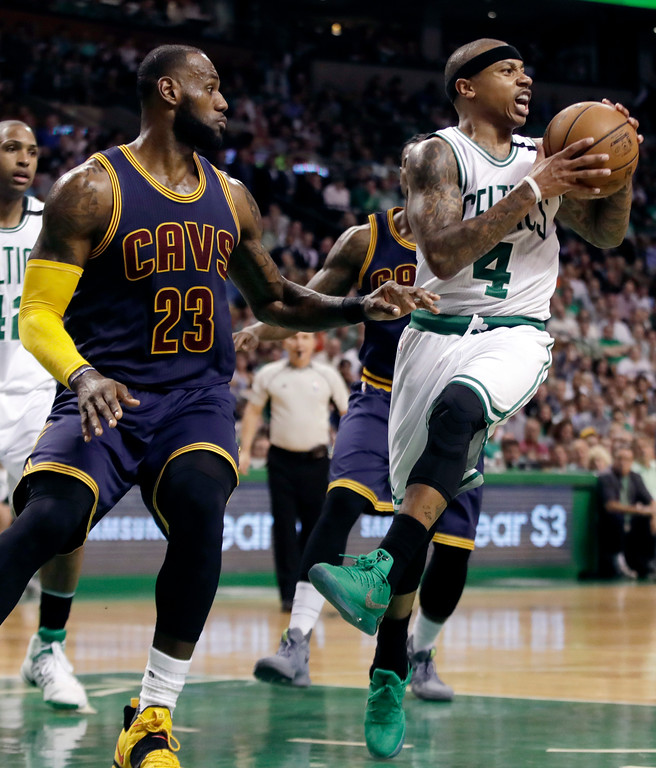 . Boston Celtics guard Isaiah Thomas (4) tries to move the ball in front of Cleveland Cavaliers forward LeBron James (23) during first half of Game 2 of the NBA basketball Eastern Conference finals, Friday, May 19, 2017, in Boston. (AP Photo/Elise Amendola)