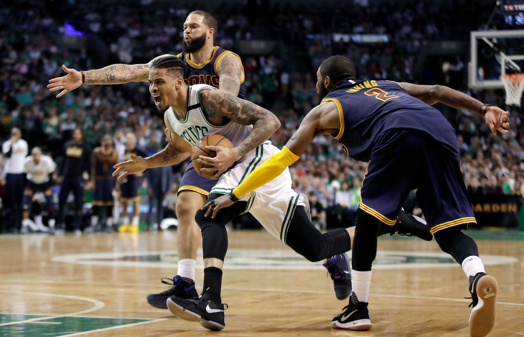 . Boston Celtics forward Gerald Green, center, drives between Cleveland Cavaliers guards Deron Williams, rear, Kyrie Irving, right, during the first half of Game 2 of the NBA basketball Eastern Conference finals, Friday, May 19, 2017, in Boston. (AP Photo/Elise Amendola)