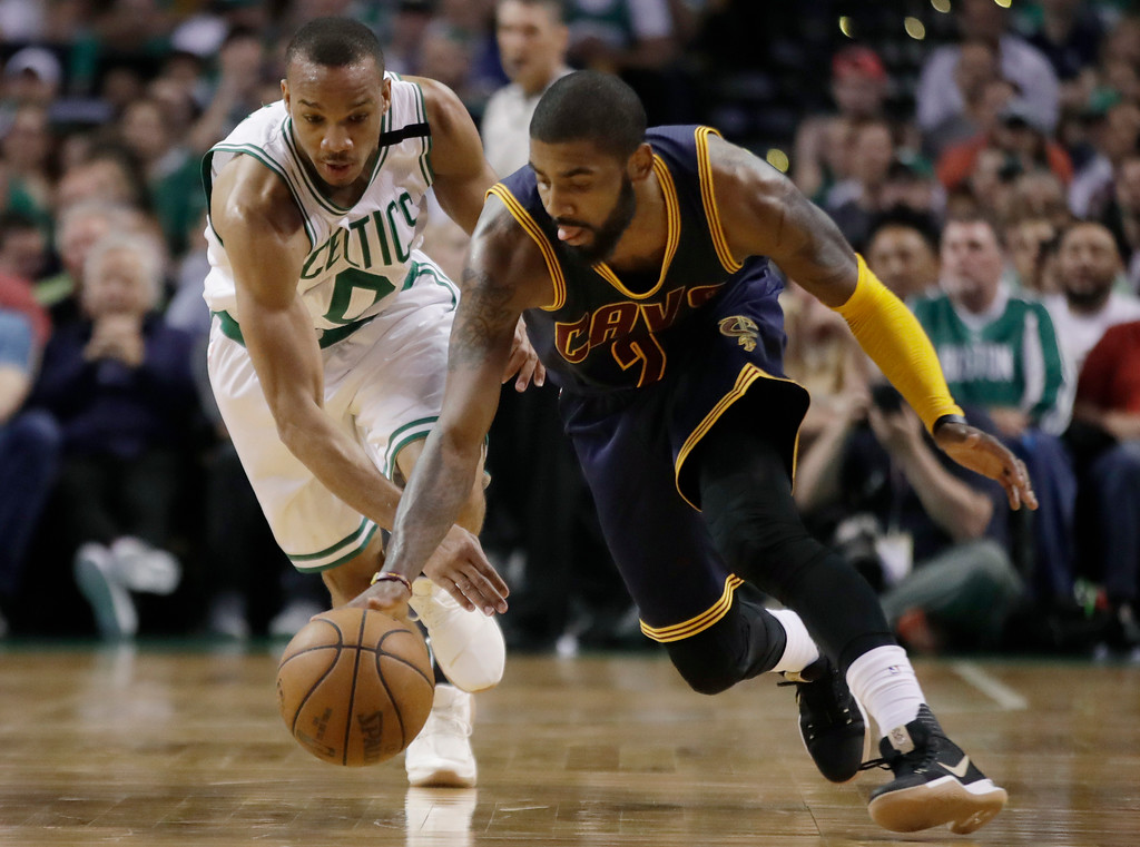 . Cleveland Cavaliers guard Kyrie Irving (2) dribbles away from Boston Celtics guard Avery Bradley (0) during the first half of Game 2 of the NBA basketball Eastern Conference finals, Friday, May 19, 2017, in Boston. (AP Photo/Elise Amendola)
