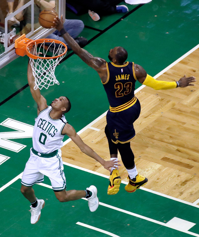 . Cleveland Cavaliers forward LeBron James, right, blocks a shot by Boston Celtics guard Avery Bradley during the first half of Game 2 of the NBA basketball Eastern Conference finals, Friday, May 19, 2017, in Boston. (AP Photo/Elise Amendola)