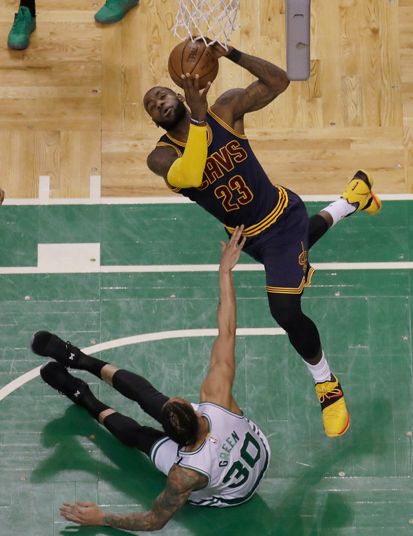 . Cleveland Cavaliers forward LeBron James (23) shoots over Boston Celtics forward Gerald Green (30) during first half of Game 2 of the NBA basketball Eastern Conference finals, Friday, May 19, 2017, in Boston. (AP Photo/Elise Amendola)