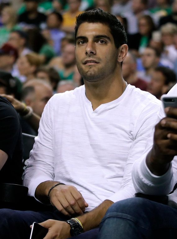 . New England Patriots quarterback Jimmy Garoppolo watches the first half of Game 2 of the NBA basketball Eastern Conference finals between the Boston Celtics and the Cleveland Cavaliers, Friday, May 19, 2017, in Boston. (AP Photo/Elise Amendola)