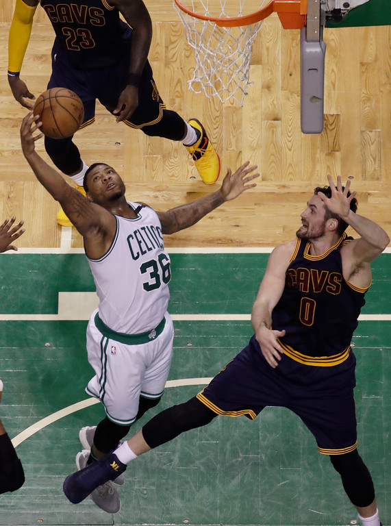 . Boston Celtics guard Marcus Smart (36) grabs a rebound in front of Cleveland Cavaliers forward Kevin Love (0) during the second half of Game 2 of the NBA basketball Eastern Conference finals, Friday, May 19, 2017, in Boston. (AP Photo/Elise Amendola)