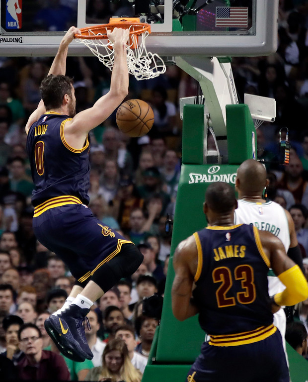 . Cleveland Cavaliers forward Kevin Love follows through on a slam-dunk against the Boston Celtics during the first half of Game 2 of the NBA basketball Eastern Conference finals, Friday, May 19, 2017, in Boston. (AP Photo/Elise Amendola)