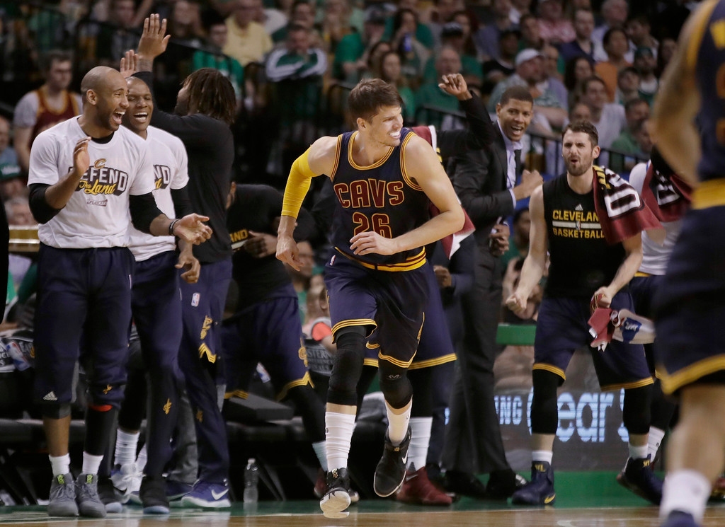 . Teammates cheer after Cleveland Cavaliers guard Kyle Korver (26) sank a three-point basket during first half of Game 2 of the NBA basketball Eastern Conference finals against the Boston Celtics, Friday, May 19, 2017, in Boston. (AP Photo/Elise Amendola)