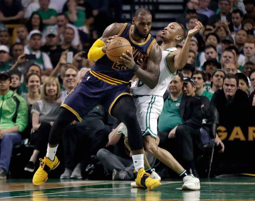. Cleveland Cavaliers forward LeBron James, left, muscles his way to the basket as Boston Celtics guard Avery Bradley, right, tries to defend during first half of Game 2 of the NBA basketball Eastern Conference finals, Friday, May 19, 2017, in Boston. (AP Photo/Elise Amendola)