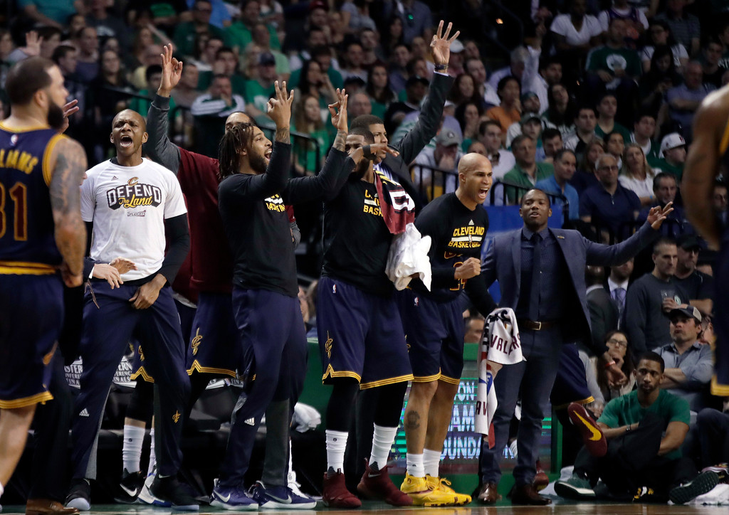 . Players on the Cleveland Cavaliers bench react after their team scored a three-point basket against the Boston Celtics during first half of Game 2 of the NBA basketball Eastern Conference finals, Friday, May 19, 2017, in Boston. (AP Photo/Elise Amendola)
