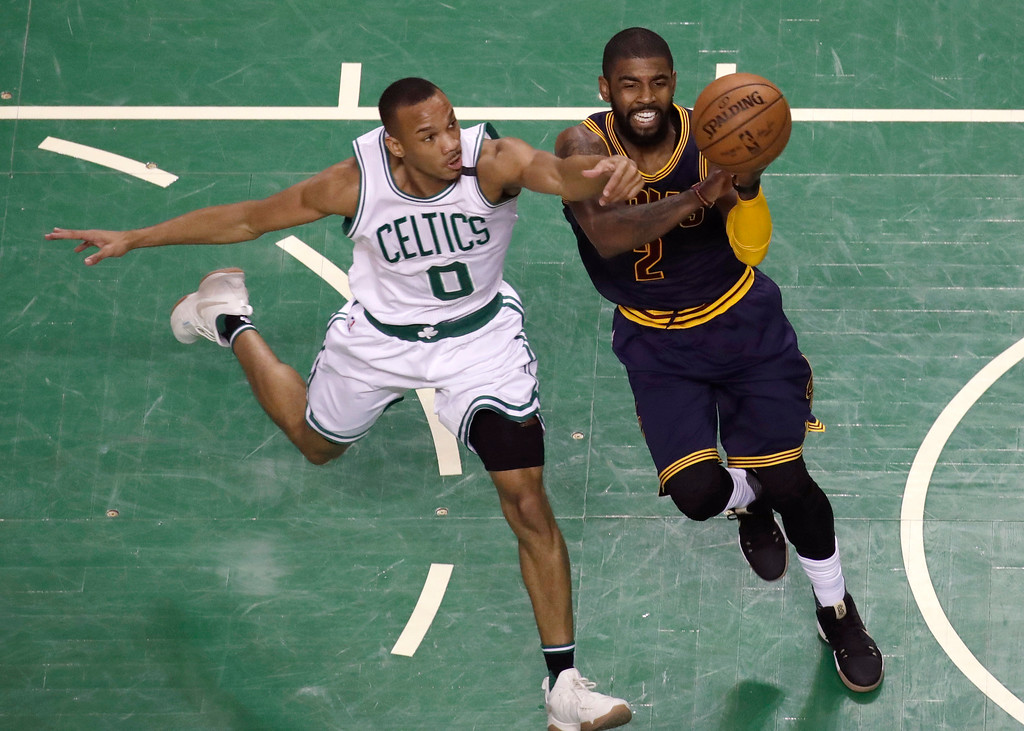 . Boston Celtics guard Avery Bradley (0) defends against Cleveland Cavaliers guard Kyrie Irving, right, during first half of Game 2 of the NBA basketball Eastern Conference finals, Friday, May 19, 2017, in Boston. (AP Photo/Elise Amendola)