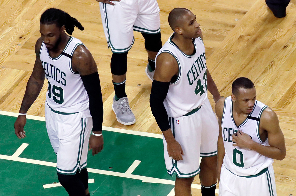 . From left, Boston Celtics\' Jae Crowder, Al Horford, and Avery Bradley stand during a stop in play in the second half of Game 2 of the NBA basketball Eastern Conference finals against the Cleveland Cavaliers, Friday, May 19, 2017, in Boston. (AP Photo/Elise Amendola)