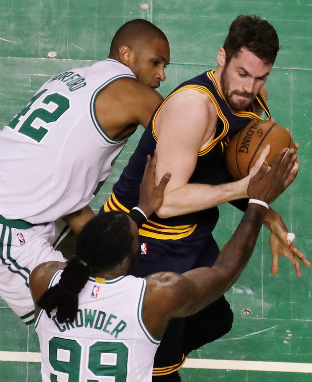 . Boston Celtics center Al Horford, left, and forward Jae Crowder (99) defend against Cleveland Cavaliers forward Kevin Love, right, during first half of Game 2 of the NBA basketball Eastern Conference finals, Friday, May 19, 2017, in Boston. (AP Photo/Elise Amendola)