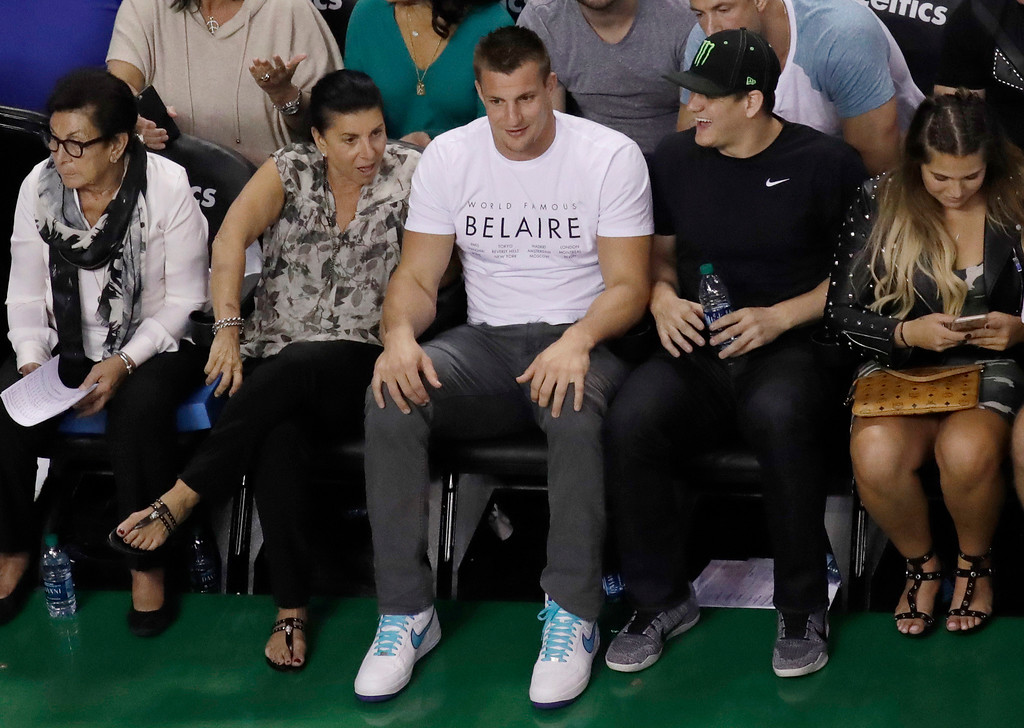 . New England Patriots tight end Rob Gronkowski, center, watches the second half of Game 2 of the NBA basketball Eastern Conference finals between the Boston Celtics and the Cleveland Cavaliers, Friday, May 19, 2017, in Boston. (AP Photo/Elise Amendola)
