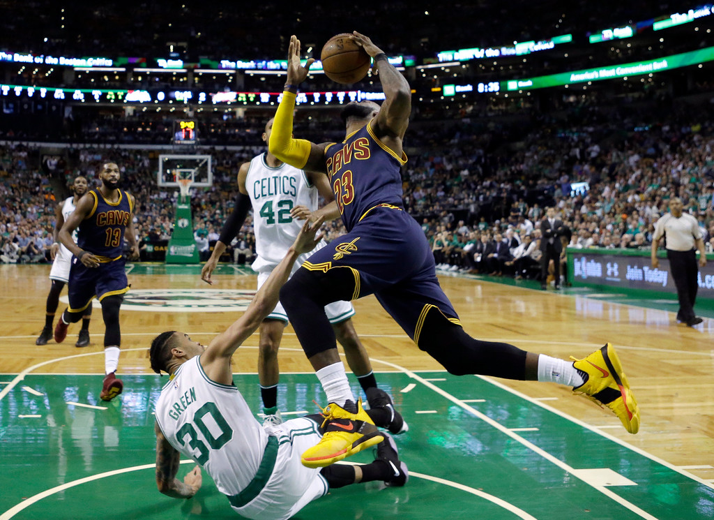 . Cleveland Cavaliers forward LeBron James (23) drives to the basket over Boston Celtics forward Gerald Green (30) during the first half of Game 2 of the NBA basketball Eastern Conference finals, Friday, May 19, 2017, in Boston. (AP Photo/Elise Amendola)