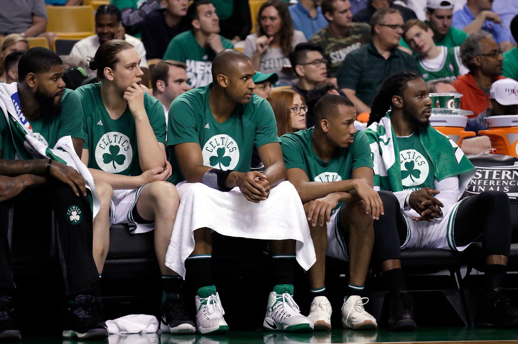 . Boston Celtics players, from left, Amir Johnson, Kelly Olynyk, Al Horford, Avery Bradley and Jae Crowder watch from the bench during the second half of Game 2 of the NBA basketball Eastern Conference finals against the Cleveland Cavaliers, Friday, May 19, 2017, in Boston. (AP Photo/Elise Amendola)