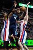 Jan 6, 2013; Auburn Hills, MI, USA; Charlotte Bobcats small forward Michael Kidd-Gilchrist (14) goes to the basket against Detroit Pistons center Greg Monroe (10) and small forward Kyle Singler (25) during the first quarter at The Palace. Mandatory Credit: Tim Fuller-USA TODAY Sports