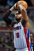 Jan 6, 2013; Auburn Hills, MI, USA; Detroit Pistons center Greg Monroe (10) shoots a free throw during overtime against the Charlotte Bobcats at The Palace. Bobcats won 108-101 in overtime. Mandatory Credit: Tim Fuller-USA TODAY Sports
