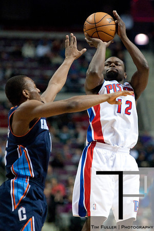 Jan 6, 2013; Auburn Hills, MI, USA; Detroit Pistons point guard Will Bynum (12) shoots during overtime against the Charlotte Bobcats at The Palace. Bobcats won 108-101 in overtime. Mandatory Credit: Tim Fuller-USA TODAY Sports