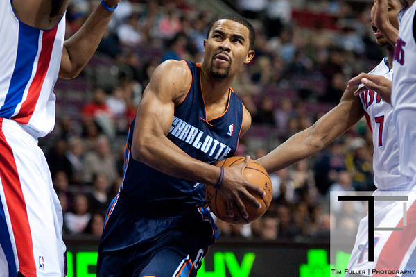 Jan 6, 2013; Auburn Hills, MI, USA; Charlotte Bobcats point guard Ramon Sessions (7) drives past Detroit Pistons defenders during the first quarter at The Palace. Mandatory Credit: Tim Fuller-USA TODAY Sports