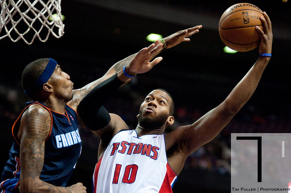 Jan 6, 2013; Auburn Hills, MI, USA; Detroit Pistons center Greg Monroe (10) goes to the basket against Charlotte Bobcats power forward Tyrus Thomas (12) during the fourth quarter at The Palace. Bobcats won 108-101 in overtime. Mandatory Credit: Tim Fuller-USA TODAY Sports