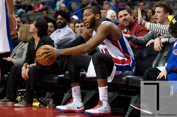 Jan 6, 2013; Auburn Hills, MI, USA; Detroit Pistons center Greg Monroe (10) sits in the stands after chasing a loose ball during overtime against the Charlotte Bobcats at The Palace. Bobcats won 108-101 in overtime. Mandatory Credit: Tim Fuller-USA TODAY Sports