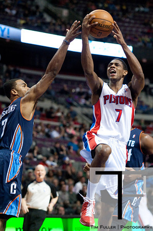 Jan 6, 2013; Auburn Hills, MI, USA; Detroit Pistons point guard Brandon Knight (7) goes to the basket against Charlotte Bobcats point guard Ramon Sessions (7) during the third quarter at The Palace. Bobcats won 108-101 in overtime. Mandatory Credit: Tim Fuller-USA TODAY Sports