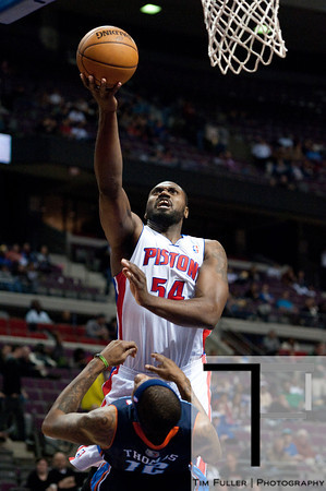 Jan 6, 2013; Auburn Hills, MI, USA; Detroit Pistons power forward Jason Maxiell (54) goes to the basket against Charlotte Bobcats power forward Tyrus Thomas (12) during the third quarter at The Palace. Bobcats won 108-101 in overtime. Mandatory Credit: Tim Fuller-USA TODAY Sports