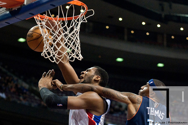 Jan 6, 2013; Auburn Hills, MI, USA; Charlotte Bobcats power forward Tyrus Thomas (12) fouls Detroit Pistons center Andre Drummond (1) during the fourth quarter at The Palace. Bobcats won 108-101 in overtime. Mandatory Credit: Tim Fuller-USA TODAY Sports
