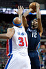 Jan 6, 2013; Auburn Hills, MI, USA; Charlotte Bobcats power forward Tyrus Thomas (12) shoots over Detroit Pistons power forward Charlie Villanueva (31) during the second quarter at The Palace. Mandatory Credit: Tim Fuller-USA TODAY Sports