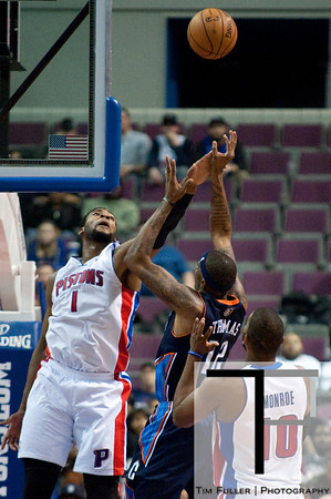 Jan 6, 2013; Auburn Hills, MI, USA; Detroit Pistons center Andre Drummond (1) blocks Charlotte Bobcats power forward Tyrus Thomas (12) during overtime at The Palace. Bobcats won 108-101 in overtime. Mandatory Credit: Tim Fuller-USA TODAY Sports