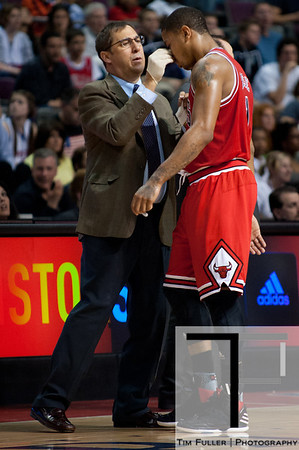 April 15, 2012; Auburn Hills, MI, USA; Chicago Bulls point guard Derrick Rose (right) is looked over by medical staff after being injured during the fourth quarter against the Detroit Pistons at The Palace. Chicago won 100-94 in overtime. Mandatory Credit: Tim Fuller-US PRESSWIRE