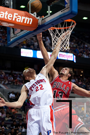 April 15, 2012; Auburn Hills, MI, USA; Detroit Pistons small forward Tayshaun Prince (22) attempts to block Chicago Bulls center Joakim Noah (13) during the first quarter at The Palace. Mandatory Credit: Tim Fuller-US PRESSWIRE