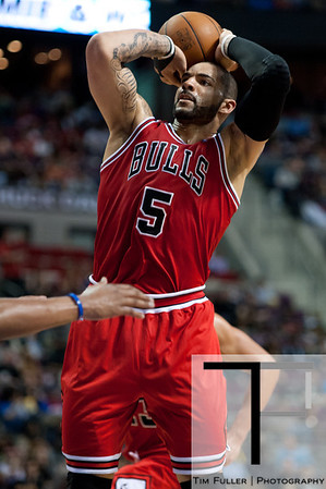 April 15, 2012; Auburn Hills, MI, USA; Chicago Bulls power forward Carlos Boozer (5) shoots a jump shot during the second quarter against the Detroit Pistons at The Palace. Mandatory Credit: Tim Fuller-US PRESSWIRE