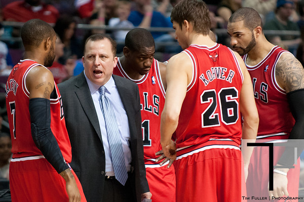 April 15, 2012; Auburn Hills, MI, USA; Chicago Bulls head coach Tom Thibodeau (second from left) talks with guards C.J. Watson (left) and  Ronnie Brewer (center), and forwards Kyle Korver (26) and Carlos Boozer (right) during the third quarter against the Detroit Pistons at The Palace. Chicago won 100-94 in overtime. Mandatory Credit: Tim Fuller-US PRESSWIRE