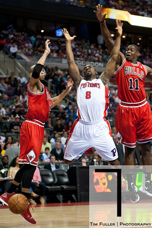 April 15, 2012; Auburn Hills, MI, USA; Detroit Pistons shooting guard Ben Gordon (8) loose control of the ball while being guarded by Chicago Bulls forward Taj Gibson (left) and shooting guard Ronnie Brewer (11) during the fourth quarter at The Palace. Chicago won 100-94 in overtime. Mandatory Credit: Tim Fuller-US PRESSWIRE
