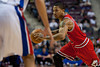 April 15, 2012; Auburn Hills, MI, USA; Chicago Bulls point guard Derrick Rose (1) drives to the basket against the Detroit Pistons during the first quarter at The Palace. Mandatory Credit: Tim Fuller-US PRESSWIRE