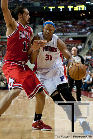 April 15, 2012; Auburn Hills, MI, USA; Detroit Pistons power forward Charlie Villanueva (31) drives to the basket against Chicago Bulls center Joakim Noah (13) during the fourth quarter at The Palace. Chicago won 100-94 in overtime. Mandatory Credit: Tim Fuller-US PRESSWIRE