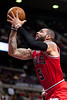 April 15, 2012; Auburn Hills, MI, USA; Chicago Bulls power forward Carlos Boozer (5) goes to the basket during the first quarter against the Detroit Pistons at The Palace. Mandatory Credit: Tim Fuller-US PRESSWIRE