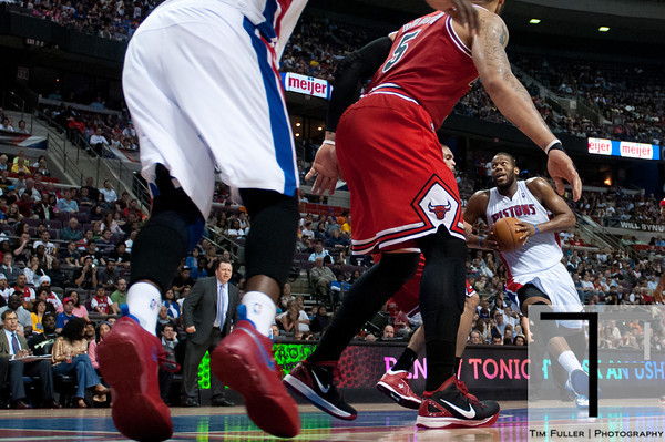 April 15, 2012; Auburn Hills, MI, USA; Detroit Pistons center Greg Monroe (right) drives to the basket during the third quarter against the Chicago Bulls at The Palace. Chicago won 100-94 in overtime. Mandatory Credit: Tim Fuller-US PRESSWIRE