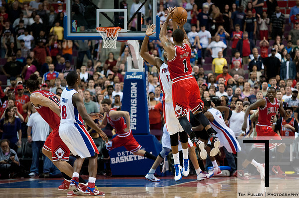 April 15, 2012; Auburn Hills, MI, USA; Chicago Bulls point guard Derrick Rose (1) makes a three point basket over Detroit Pistons center Greg Monroe (10) to send the game into overtime during the fourth quarter at The Palace. Chicago won 100-94 in overtime. Mandatory Credit: Tim Fuller-US PRESSWIRE